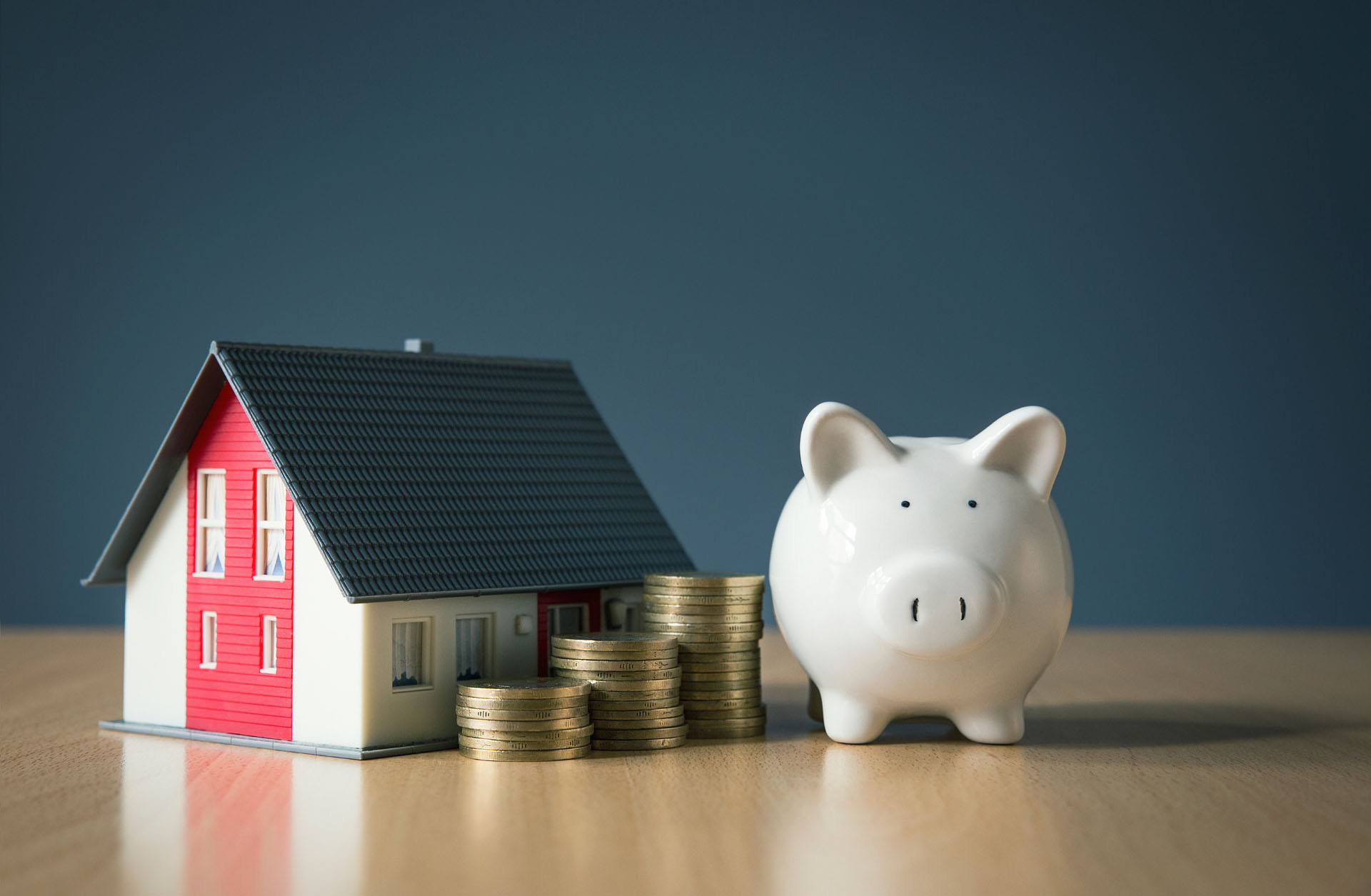 Piggy bank, coins and mock home