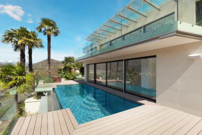 A home with a swimming pool and palm trees