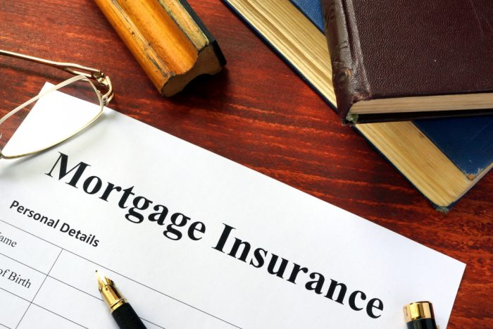Piece of paper that says Mortgage Insurance written on the top in bold text